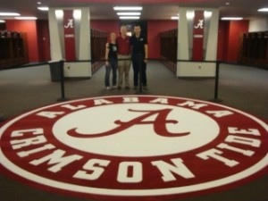 Mateja Loncar, Andy Billings, and Simon Ličen in the Crimson Tide locker room at Bryant-Denny Stadium